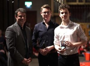 Samuel Tannenbaum (right) is presented the Barnes Young Musician medal by Craig Ogden and Daniel Turner